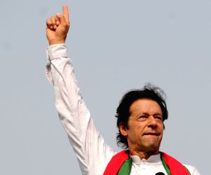 ISLAMABAD, Aug. 21, 2014 (Xinhua) -- Pakistani opposition leader Imran Khan addresses his supporters during a protest in Islamabad, capital of Pakistan, Aug. 21, 2014. Pakistani parliament on Thursday unanimously passed a resolution, rejecting demand