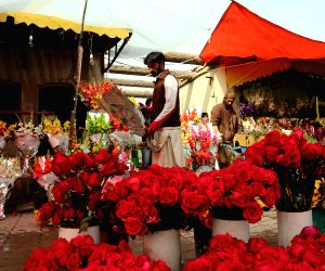 Islamabad, Feb. 14, 2018 - A seller arranges flowers on Valentine's Day in Islamabad, Pakistan on Feb. 14, 2018.