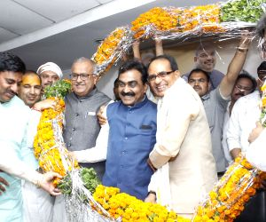 Jabalpur Lok Sabha MP Rakesh Singh being felicitated in the presence of Madhya Pradesh Chief Minister Shivraj Singh Chauhan, after he took charge as the state's new party president, in Bhopal ...