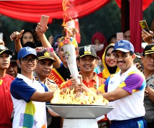 Asiad flame enters Jakarta, to be paraded in city