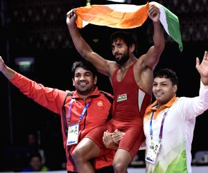 Wrestler Bajrang clinches Asiad gold, Sushil flops