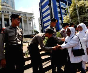 Indonesian police personnel are deployed in securing the Constitutional Court
