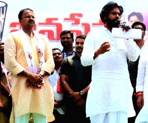 Jana Sena Party President Pawan Kalyan addresses during a public rally in Andhra Pradesh's Gajuwaka, on April 4, 2019. Also seen Former CBI Joint Director and Jana Sena Party leader V.V. ...