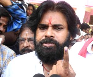 Jana Sena Party President Pawan Kalyan shows his fore finger marked with indelible ink after casting vote during the first phase of Lok Sabha election, in Hyderabad, on April 11, 2019.