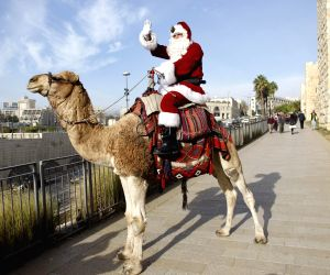 JERUSALEM, Dec. 21, 2017 - A man dressed as Santa Claus rides a camel in Jerusalem's Old City, on Dec. 21, 2017.