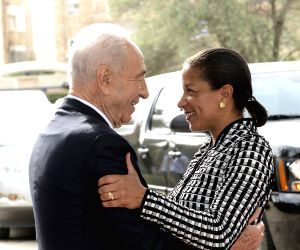 Israeli President Shimon Peres (L) greets U.S. National Security Adviser Susan Rice at the President's Residence in Jerusalem