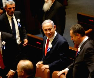 JERUSALEM, Oct. 4, 2019 - Israeli Prime Minister Benjamin Netanyahu (C) attends the swearing-in ceremony of the Knesset in Jerusalem on Oct. 3, 2019. Israeli lawmakers were sworn into the new ...