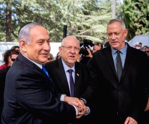 JERUSALEM, Sept. 19, 2019 - Israeli Prime Minister Benjamin Netanyahu (L), Israeli President Reuven Rivlin (C) and Blue and White party leader Benny Gantz attend a memorial service for late Israeli ...