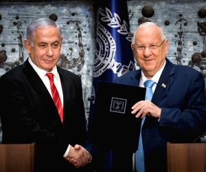 JERUSALEM, Sept. 25, 2019 - Israeli President Reuven Rivlin (R) hands a letter of appointment to Israeli Prime Minister and Chairman of the Likud Party Benjamin Netanyahu at the President's residence ...