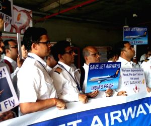 Jet Airways employees stage a protest at Chhatrapati Shivaji International Airport, in Mumbai, on May 8, 2019.