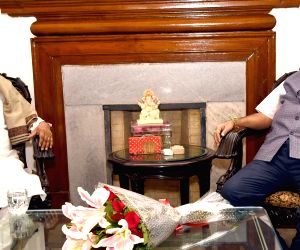 Jharkhand Chief Minister Raghubar Das meets Union Road Transport and Highways and Micro, Small and Medium Enterprises Minister Nitin Gadkari, in New Delhi on June 16, 2019.