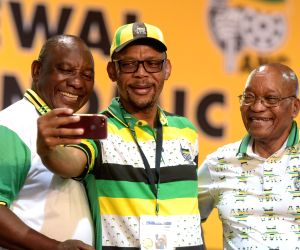 JOHANNESBURG, Dec. 18, 2017 - A representative takes a selfie with Cyril Ramaphosa (L) and South Africa's ruling party African National Congress (ANC) President Jacob Zuma (R) at ANC's conference in ...