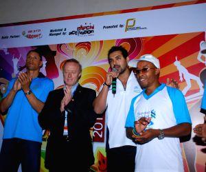 John promotes Mumbai Marathon at WTC.