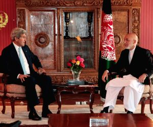 U.S. Secretary of State John Kerry meets with Afghan President Hamid Karzai at the Presidential Palace in Kabul