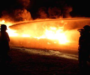 Oil tanker trucks hit by rockets