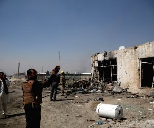 KABUL, March 17, 2018 - Security force members inspect a suicide bombing site in Kabul, capital of Afghanistan, March 17, 2018. A Taliban claimed suicide car bombing in Kabul on Saturday left at ...
