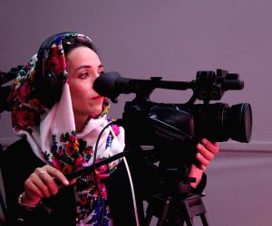 AFGHANISTAN KABUL TV STATION WOMAN