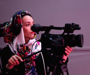 AFGHANISTAN KABUL TV STATION WOMAN