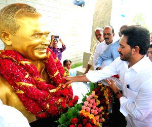 Kadapa:Andhra Pradesh Chief Minister Y.S. Jagan Mohan Reddy pays tributes to his father Y. S. Rajasekhara Reddy on his 70th birth anniversary, at his memorial at Idupulapaya in Kadapa district of Andhra Pradesh on July 8, 2019. (Photo: IANS)