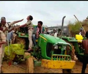 Kagaznagar: A woman forest officer seen being attacked by a leader and workers of the ruling Telangana Rashtra Samithi (TRS) in Telangana's Kagaznagar on June 30, 2019. The TRS leader and his followers, including farmers rained blows with sticks on F