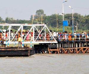 Pilgrims proceed towards Gangasagar island