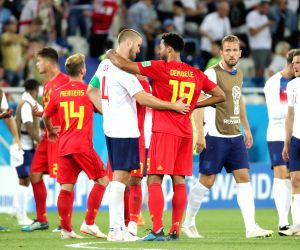 Belgium pip England to top Group G