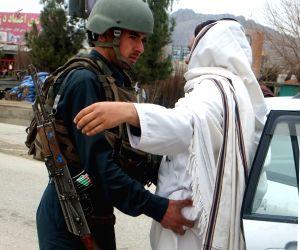 KANDAHAR, Feb. 21, 2019 - An Afghan policeman frisks a man at a security checkpoint on the way leading to Panjwai district of Kandahar province, Afghanistan, Feb. 20, 2019 . The Afghan security ...