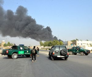 KANDAHAR, July 18, 2019 - Members of Afghan security forces stand guard at the site of the attack outside the provincial police headquarters in Kandahar, capital of Afghanistan's southern Kandahar ...