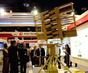 Visitors look at a tank during the International Defence Exhibition