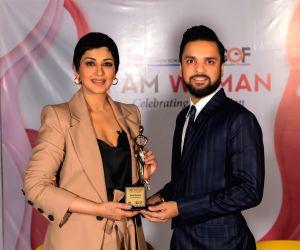 Karan Gupta Education Foundation Founder Karan Gupta presents the 'I Am Woman' award to actress Sonali Bendre in Mumbai, on April 23, 2019.