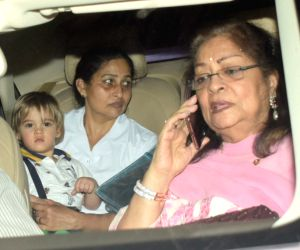 Karan Johar's mother Hiroo Johar with her grandson Yash arrive at Adira's birthday party hosted by her parents Rani Mukerji and Aditya Chopra in Mumbai on Dec 9, 2018.