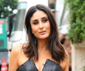 Kareena Kapoor takes us back to her oomph filled glam shoots in this deep plunging satin dress