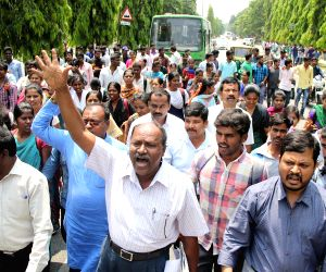 Karnataka State Higher Education Council (KSHEC) members stage a demonstration over the Supreme Court's refusal to stay its ruling on the Scheduled Castes and Scheduled Tribes (Prevention ...
