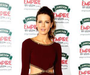 Kate Beckinsale's deep purple flaunt in lingerie