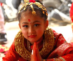 KATHMANDU, Feb. 23, 2018 - A girl from Newar community attends a Bel Bibaha ceremony in Kathmandu, capital of Nepal, Feb. 23, 2018. Bel Bibaha, or Ihi, is a marriage ceremony in the Newar community ...
