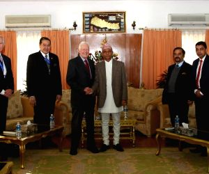 Former U.S. President Jimmy Carter (3rd L) shakes hands with Nepal's Interim Election Chairman Khilraj Regmi (4th L) in Kathmandu, Nepal, Nov. 17, 2013. ...