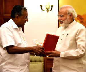Modi discusses flood situation with Kerala CM