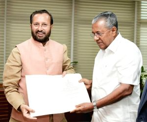 Kerala Chief Minister Pinarayi Vijayan calls on Union Minister for Environment, Forest & Climate Change and Information & Broadcasting Prakash Javadekar, in New Delhi on Oct 1, ...