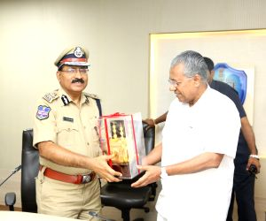 Kerala Chief Minister Pinarayi Vijayan meets Telangana Director General of Police M Mahendar Reddy at Panjagutta police station in Hyderabad on April 19, 2018.