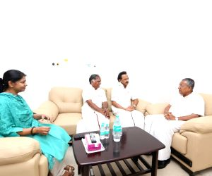 Kerala Chief Minister Pinarayi Vijayan with DMK leaders M.K. Stalin and Kanimozhi during his visit to the Kauvery Hospital where DMK President M. Karunanidhi is admitted, in Chennai on Aug ...