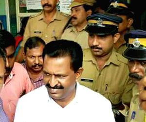 Kerala Congress legislator M Vincent, who is arrested on the charges of sexual harassment and stalking of a 51-year-old woman who attempted suicide being take away by police in ...