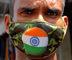 People wear tricolored masks to mark 74th Independence Day