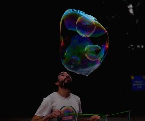 Bubble artist performs in front of Victoria Memorial