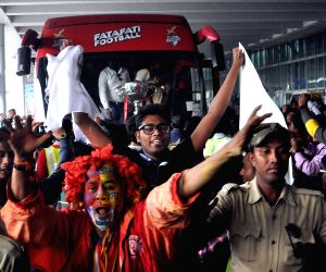Kolkata: Atletico de Kolkata fans celebrate at Kolkata Airport