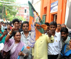 BJP workers burn party flags