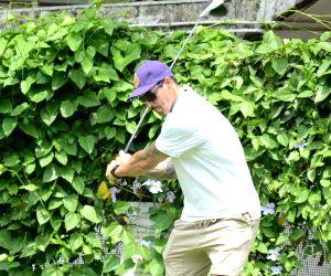 Mitchell Johnson seen playing golf