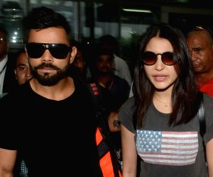Virat Kohli, Anuskha Sharma at Kolkata Airport