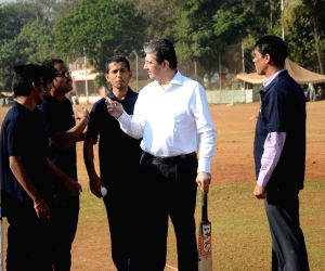 Uday Kotak plays cricket with blind cricketers
