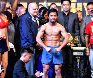Pacquiao wins welterweight title in TKO victory