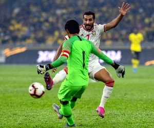 KUALA LUMPUR, Sept. 11, 2019 - Ali Ahmed Mabkhout (Back) of the United Arab Emirates vies with Mohd Farizal Marlias of Malaysia during the FIFA World Cup Qatar 2022 and AFC Asian Cup China 2023 ...
